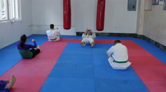 Student doing crunches on aikido training by Pakito Stock Footage