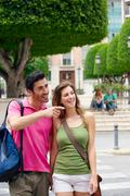 Tourist couples sightseeing Stock Photos