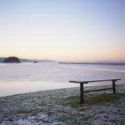 Bench by sea, wintertime Stock Photos