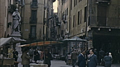 Vicenza 1958: people walking in an outdoor market - stock footage