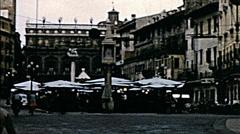 Verona 1958: people walking in Piazza delle Erbe Stock Footage