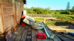 4K Fishing Community Building, Ropes, Fuel Canister and Grassland Marsh Stock Footage