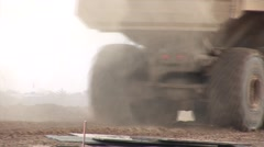 Large John Deere Dump Truck Driving on Construction Site Stock Footage