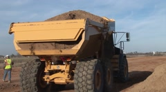 Back of Large Dump Truck Dropping Load Stock Footage