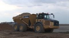 Large Dump Truck backing up and Dumping Stock Footage