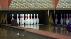 Slow motion shot of a bowling ball hitting pins - stock footage