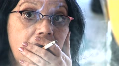 Close up of a senior woman smoking  Stock Footage