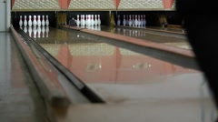 Slow motion shot of ball hitting the bowling pins - stock footage