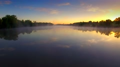 Stunning sky reflected in foggy river at sunrise Stock Footage
