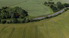 Aerial view - Flight Over a country road between Agricultural Fields in germany Stock Footage