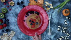 4k food composition on a vintage background with pancakes in a red plate - stock footage