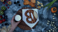 4k food composition on a vintage background with pretzel and milk - stock footage