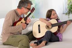 Father and daughter making music Stock Photos