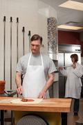 Chefs preparing food in commercial kitchen Stock Photos