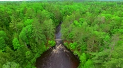 Aerial tour of Wisconsin wilderness with white water rapids - stock footage