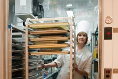 Female chef in walk in freezer in commercial kitchen Stock Photos