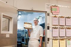 Male chef in walk in freezer in commercial kitchen Stock Photos