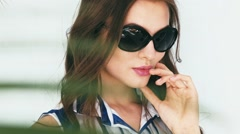 Beautiful sexy brunette woman sunglasses summer collection Stock Footage