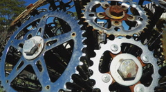 Close Up Pan Of Sculpture Made Of Bicycle Sprockets Stock Footage