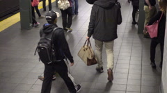 zooming out from homeless man on subway floor with cup NYC 4K and HD - stock footage