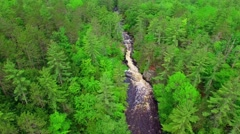 Aerial tour of Wisconsin wilderness with white water rapids Stock Footage