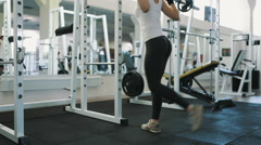 Fit girl with sexy body doing barbell workout routine in gym, healthy lifestyle - stock footage