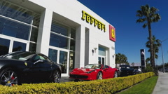 Ferrari Luxury Sports Cars Outside Dealership With Sign- Zoom Stock Footage