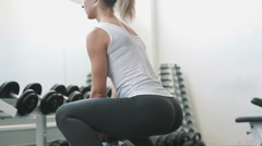 athletic girl do Sumo Squats in gym - stock footage