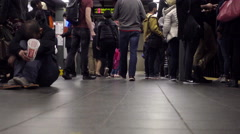 subway station platform with hungry homeless man shaking cup and rocking 4K NYC - stock footage