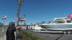 Man Looks Longingly At Luxury Boats - Newport Beach Stock Footage