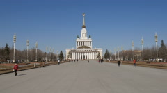 Road to a main pavilion of VDNKh, Moscow in sunny day Stock Footage