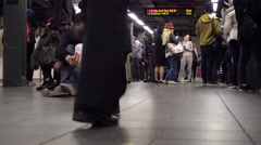 homeless man in subway station with cup 4K NYC - stock footage