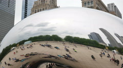 Tourists at the Chicago Bean Monument in Millennium Park Closeup Stock Footage