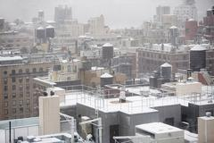 Snow on roof tops Stock Photos