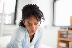 Woman looking depressed Stock Photos