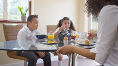 4K Happy family eating breakfast together, mother gives her children a kiss Stock Footage