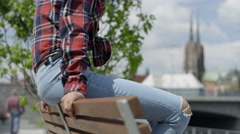 Unrecognizable portrait of  young  woman in urban background. Stock Footage