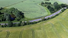 Drone Aerial Flight Over a country road between Agricultural Fields in germany Stock Footage