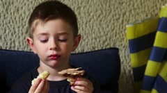 Young boy eating Stock Footage
