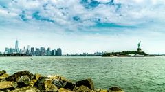 The panoramic view of the Manhattan skyline and the Statue of Liberty - stock footage