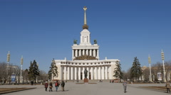 People are walking in front of main pavilion of VDNKh, Moscow in sunny day Stock Footage