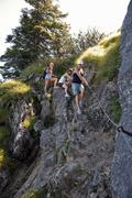 Girls rockclimbing through the foothills - stock photo