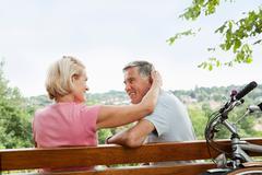 Mature woman embraces partner - stock photo