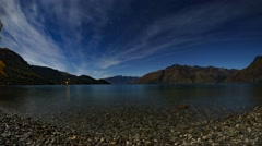 A Cloudy Night With Moon Shine near Lake Wakatipu Stock Footage