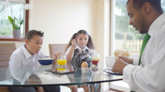 4K Happy family eating breakfast together, father gives his children a kiss Stock Footage