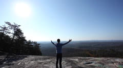 Successful Hiker at the top with arms stretched out Stock Footage