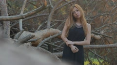 Beautiful girl on a background of dry branches Stock Footage