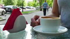 Woman drinking coffee. Glasses are nearby the cup Stock Footage