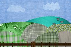 Patchwork field with cows - stock photo