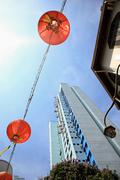Lanterns and high rise in singapore china town - stock photo
